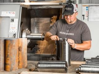 man creating a pump plunger